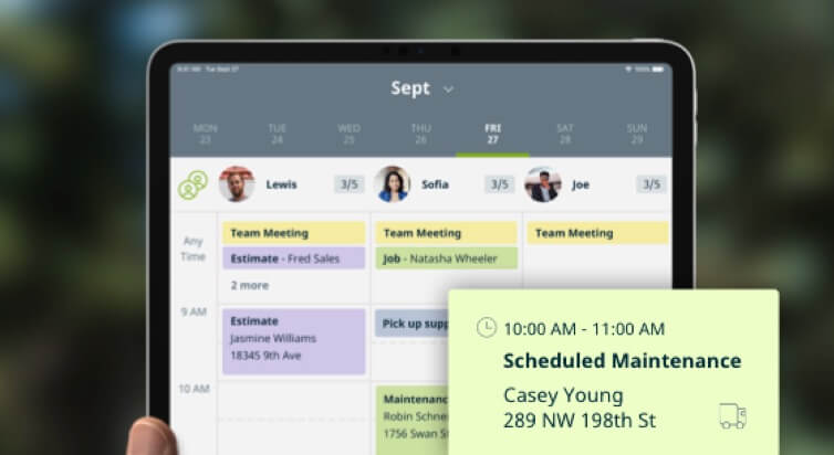 An iPad with the Jobber app open, showing a schedule alert.