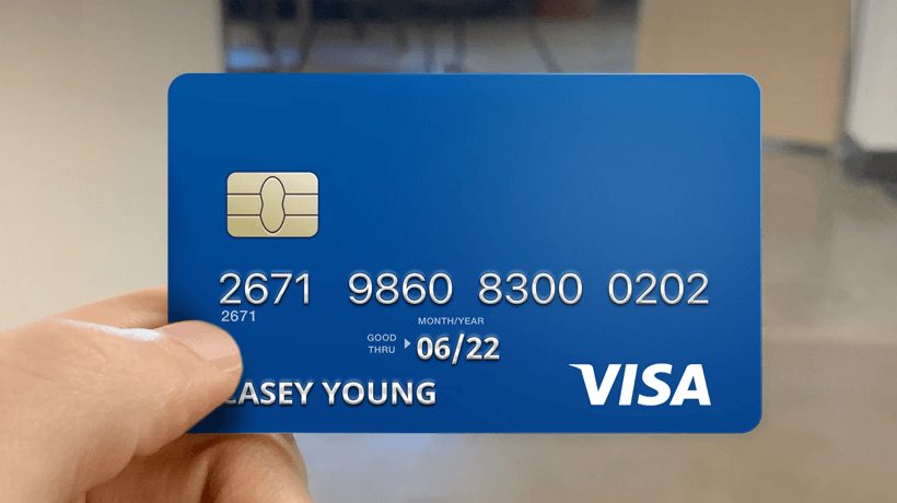 Visa credit card being used to pay for a job.